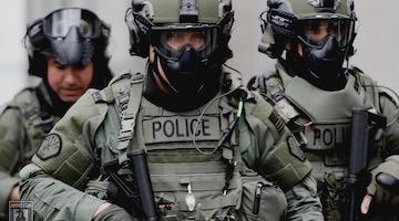 US Cops Act Like Soldiers, While US Soldiers Police the World